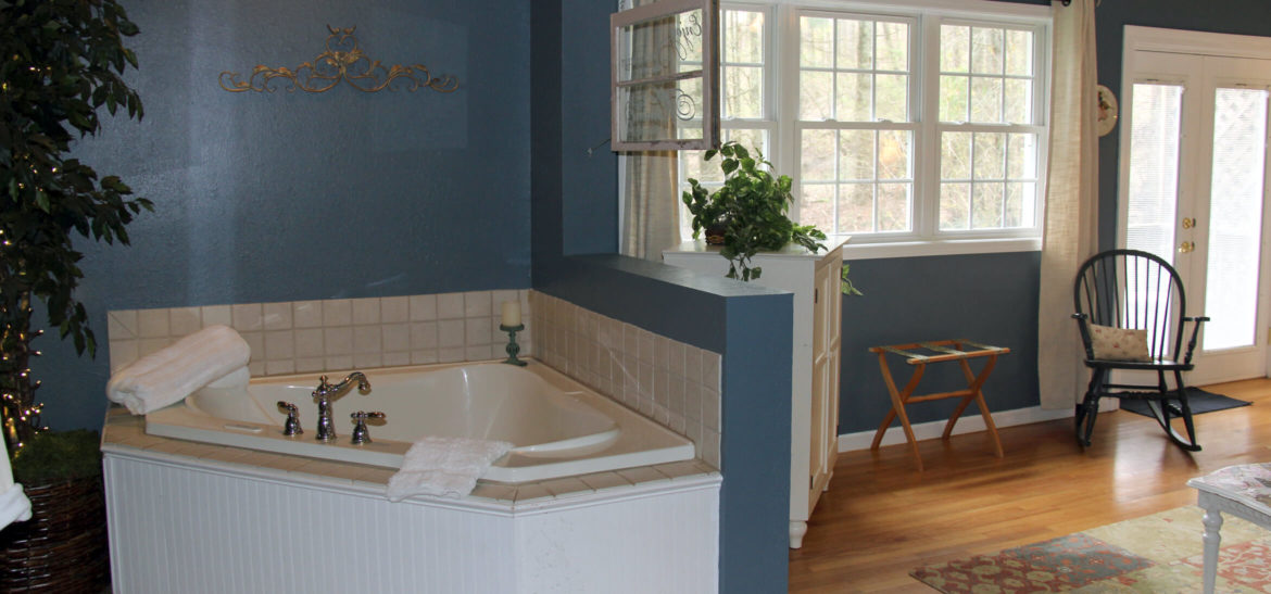 Cottage Suite fireplace and Jacuzzi bath