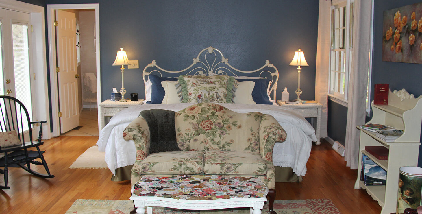 Cottage Suite sitting area, and bed