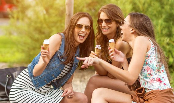 Group of girlfriends eating ice cream cones