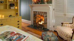 Carolina room fireplace and chair