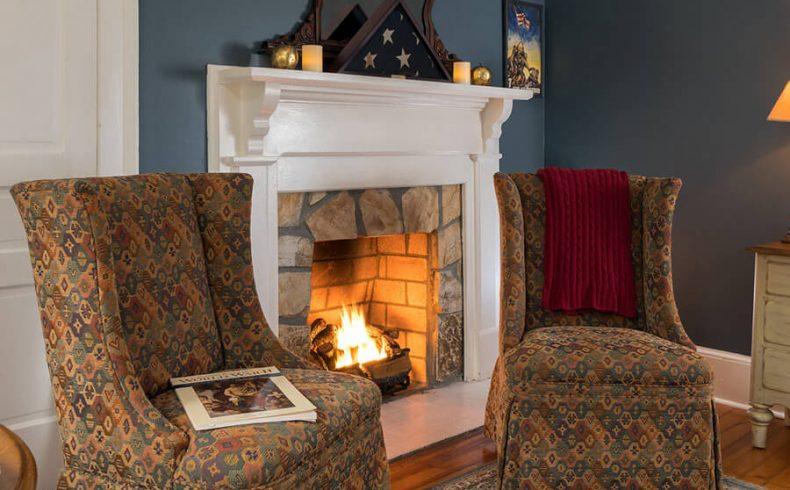 The Patriots Quarters sitting area with fireplace