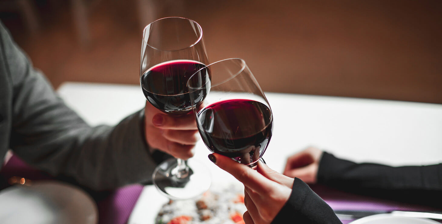 Toasting Red Wine at a Restaurant